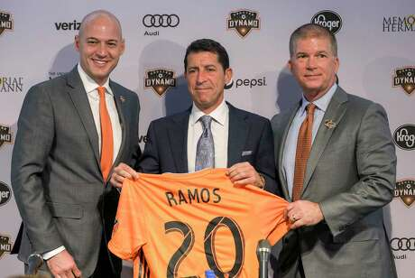 New Dynamo coach Tab Ramos is flanked by general manager Matt Jordan, left, and president of business operations John Walker at his introductory news conference at BBVA Stadium on Wednesday.