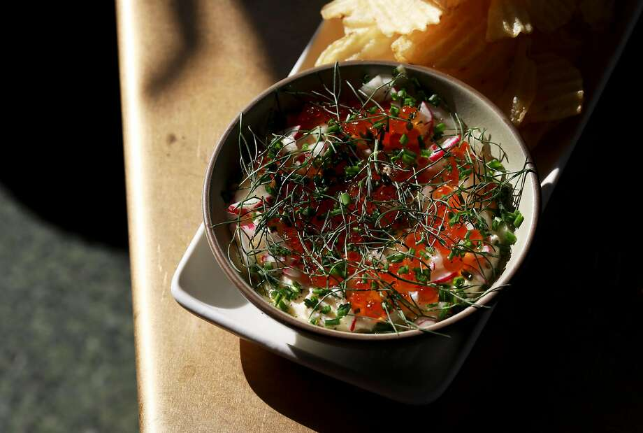 At Here's How in Oakland, potato chips with whipped ricotta features house-made ricotta, cured salmon roe, fennel, radish and chive. Photo: Yalonda M. James / The Chronicle