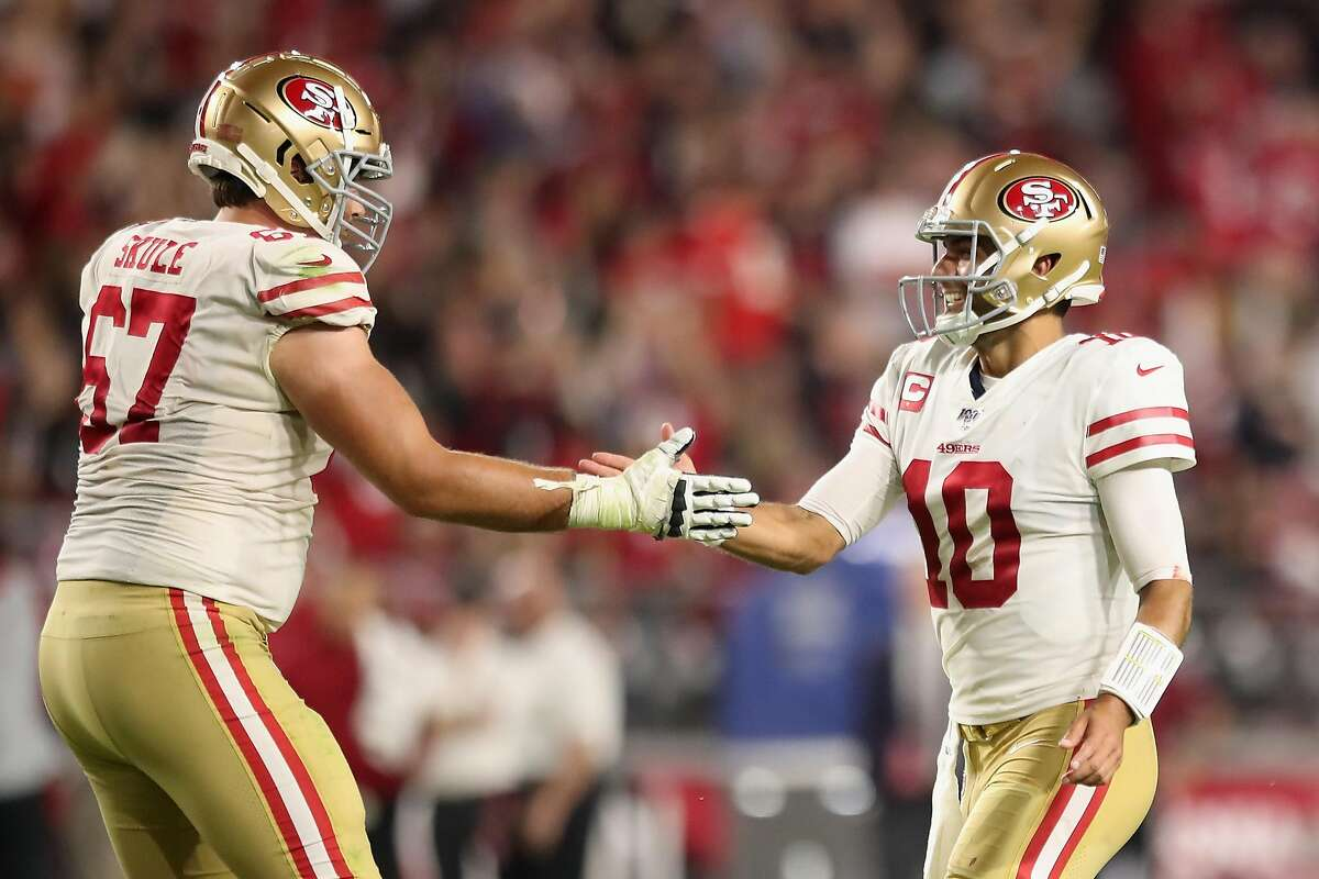 Quarterback Jimmy Garoppolo #10 of the San Francisco 49ers celebrates with offensive tackle Justin Skule #67 after throwing a 21 yard touchdown reception to Dante Pettis (not pictured) during the second half of the NFL game against the Arizona Cardinals at State Farm Stadium on October 31, 2019 in Glendale, Arizona. The 49ers defeated the Cardinals 28-25. (Photo by Christian Petersen/Getty Images)