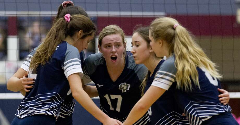 College Park setter Annie Cooke (17) talks with players during the first set of a District 15-6A high school volleyball match, Tuesday, Oct. 29, 2019, in The Woodlands. Photo: Jason Fochtman/Staff Photographer