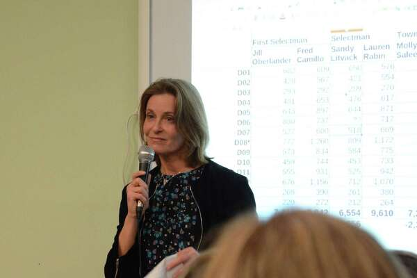 Jill Oberlander speaks to a crowd after she lost her race for first selectman on Tuesday night. Democrats are looking at what happened after across the board defeats at a time when the party appeared to be making gains in town.