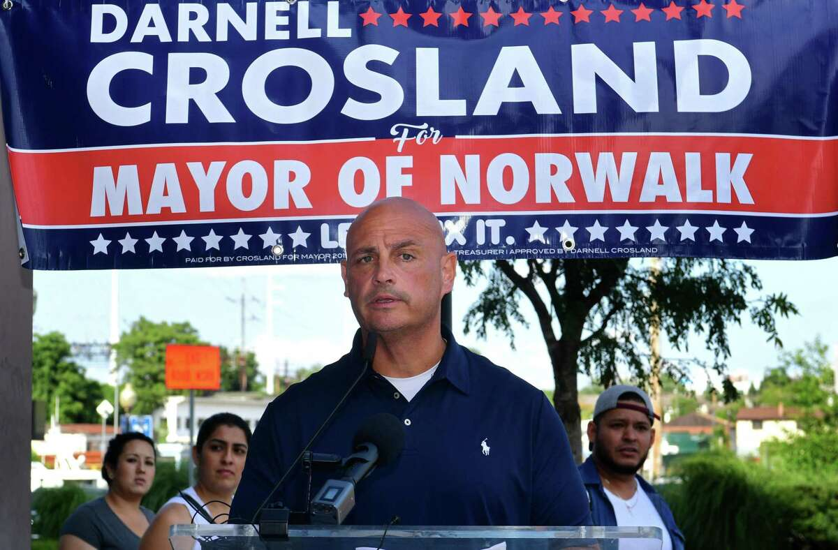 Norwalk Republican Town Committee chairman Mark Suda introduces mayoral candidate Darnell Crosland who announced the suspension of his campaign and his intention to run for Common Council as the RTC holds a press conference Thursday, August 1, 2019, at Washington Prime restuarant in Norwalk, Conn.