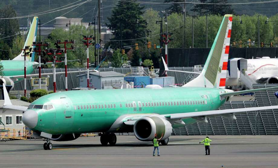 FILE - In this May 8, 2019, file photo workers stand near a Boeing 737 MAX 8 jetliner being built for American Airlines prior to a test flight in Renton, Wash. American Airlines CEO Doug Parker says his airline is feeling more confident that its grounded Boeing 737 Max jets will soon be approved to fly again. (AP Photo/Ted S. Warren, File) Photo: Ted S. Warren / Copyright 2019 The Associated Press. All rights reserved.