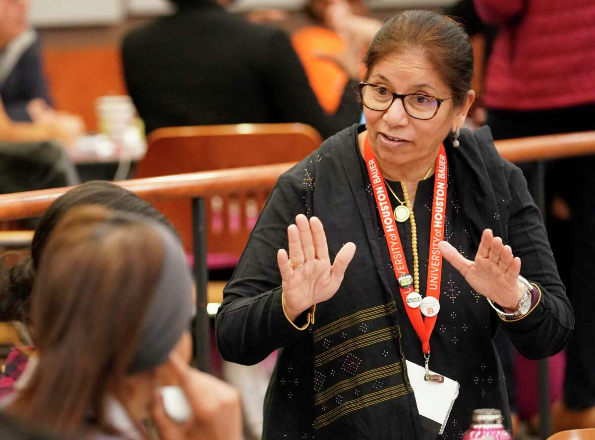 Saleha Khumawala, founding director, talks with participants in the SURE (Stimulating Urban Renewal through Entrepreneurship) program at the University of Houston Saturday, Nov. 2, 2019, in Houston.
