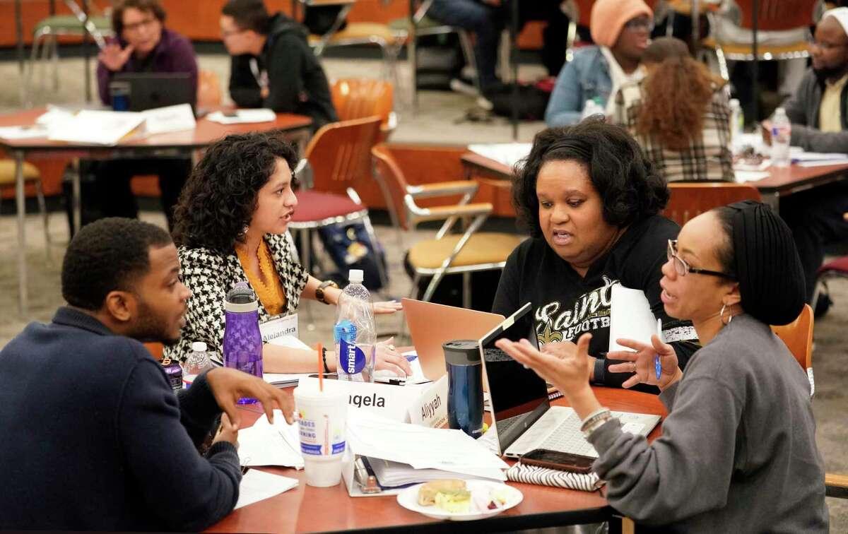 People participate in the SURE (Stimulating Urban Renewal through Entrepreneurship) program at the University of Houston Saturday, Nov. 2, 2019, in Houston.