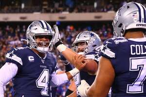EAST RUTHERFORD, NJ - NOVEMBER 04:  Dallas Cowboys quarterback Dak Prescott (4) celebrates afterthrowing a touchdown pass during the fourth quarter of the National Football League game between the New York Giants and the Dallas Cowboys on November 4, 2019 at MetLife Stadium in East Rutherford, NJ.   (Photo by Rich Graes fourthsle/Icon Sportswire via Getty Images)