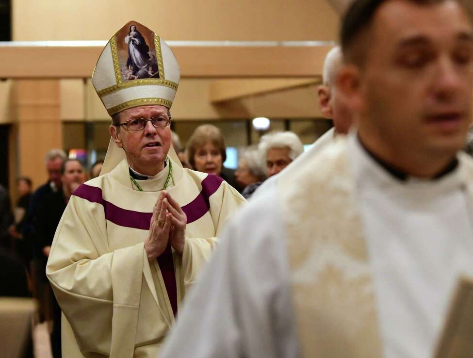 Bishop Edward Scharfenberger walks down the aisle as people attend a funeral mass at Church of the Immaculate Conception to remember Rev. John Thomas Connery on Wednesday, Nov. 6, 2019 in Glenville, N.Y. Connery was the priest who drowned in last week's flooding. (Lori Van Buren/Times Union)