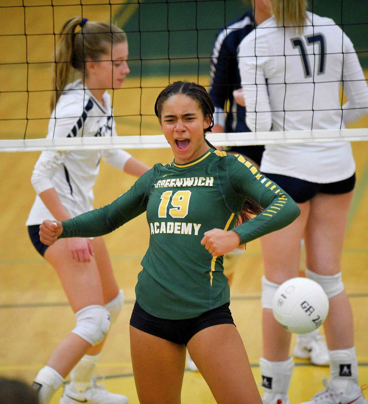 Greenwich Academy's Alexandra Trofort (19) celebrates a point in the first set against King in a FAA Volleyball semifinal match at Greenwich Academy on Nov. 6, 2019 in Greenwich, Connecticut.