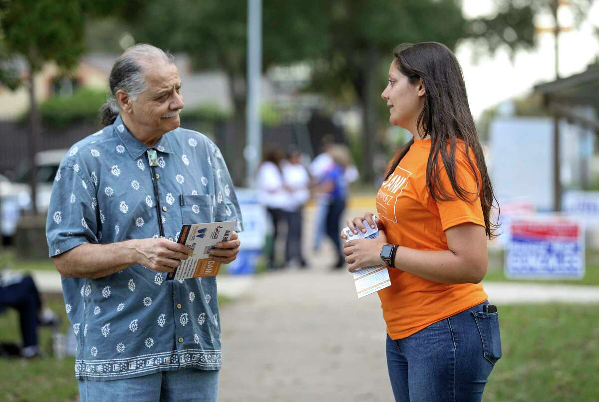 Dani Hernandez, right, a candidate for HISD Board of Trustees District III, talks with Roland Lopez before he votes at Mason Park on Tuesday, Nov. 5, 2019, in Houston. Hernandez defeated incumbent Sergio Lira, earning nearly two-thirds of the vote.