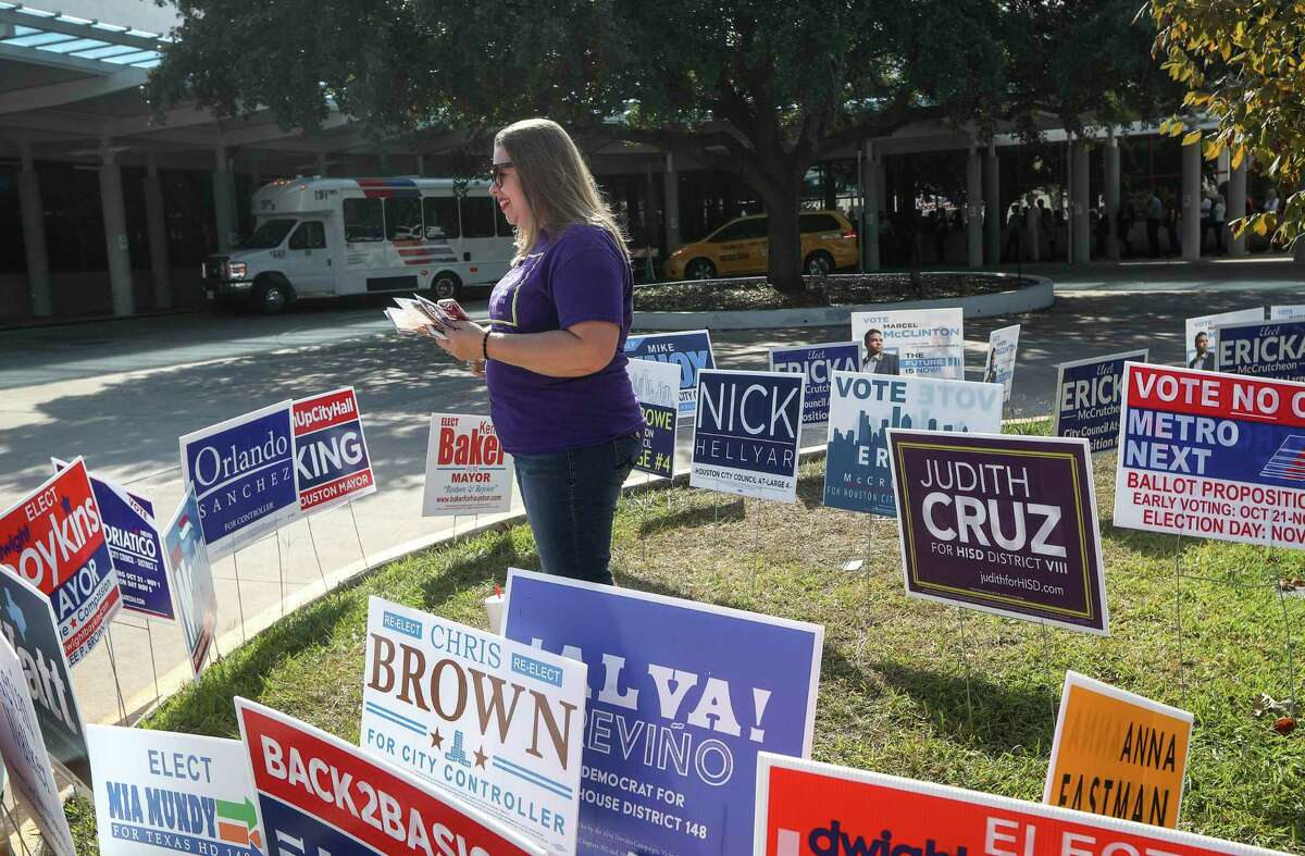 Judith Cruz, a candidate for HISD Board of Trustees District VIII, campaigns at the West Gray Metropolitan Multi-Service Center on Tuesday, Nov. 5, 2019, in Houston. Texas Education Agency investigators recommended replacing HISD trustees with a state-appointed governing board.