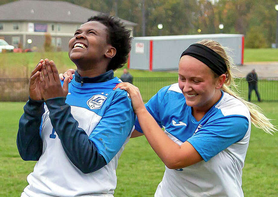 LCCC's Boiumelo Rabale, left, and teammate Payton Corley celebrate their team's 1-0 overtime victory over Southwestern Illinois College in Monday's Region 24 Tournament championship game at Tim Rooney Stadium. The No. 5-ranked Trailblazers will face Metropolitan Community College of Kansas City at 2 p.m. Thursday in a semifinal of the Central District Tournament at STLCC-Meramec in Kirkwood, Missouri. Photo: Jan Dona | For The Telegraph