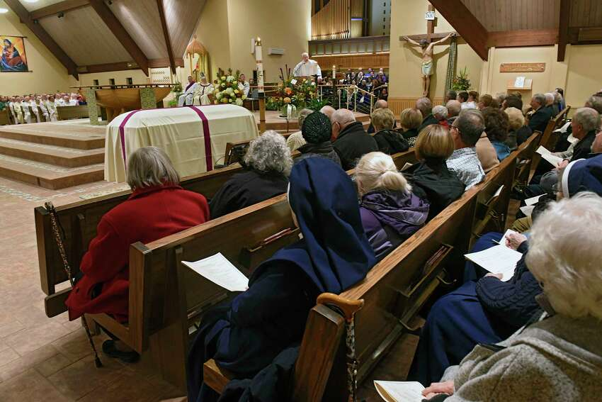People attend a funeral mass at Church of the Immaculate Conception to remember Rev. John Thomas Connery on Wednesday, Nov. 6, 2019 in Glenville, N.Y. Connery was the priest who drowned in last week's flooding. (Lori Van Buren/Times Union)