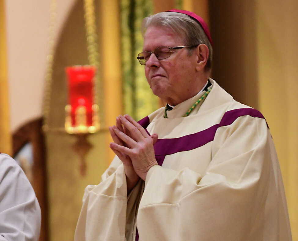 Bishop Edward Scharfenberger is seen on the alter as people attend a funeral mass at Church of the Immaculate Conception to remember Rev. John Thomas Connery on Wednesday, Nov. 6, 2019 in Glenville, N.Y. Connery was the priest who drowned in last week's flooding. (Lori Van Buren/Times Union)