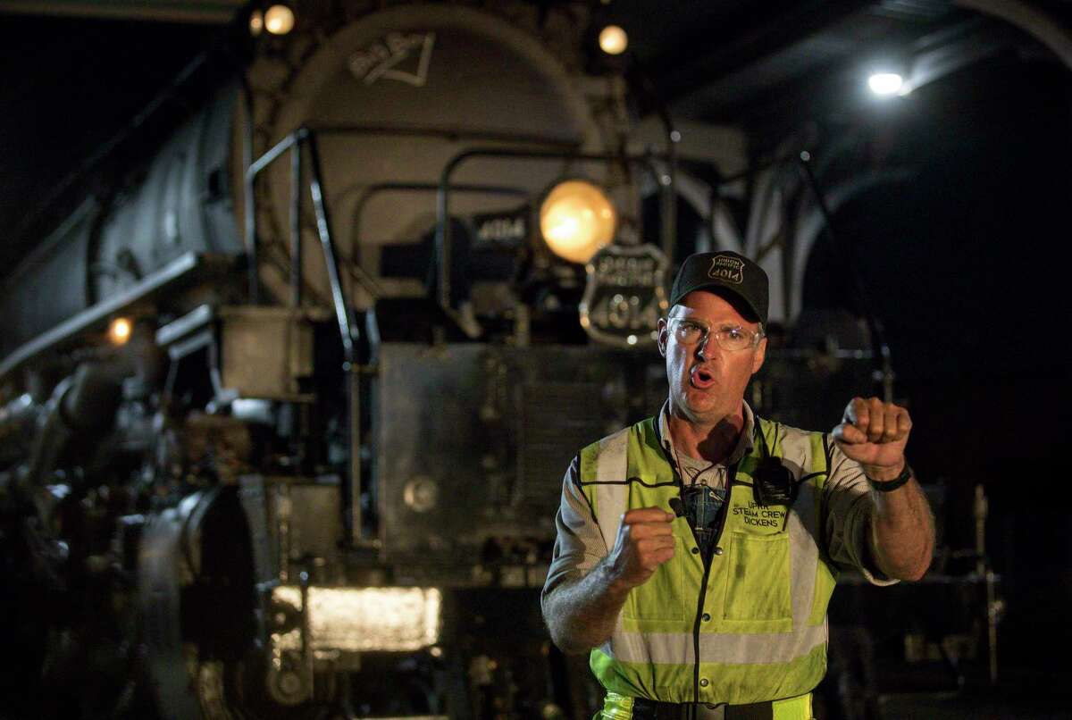 Ed Dickens, the locomotive engineer for Union Pacific engine 4014, aka the Big Boy, explains the process of driving the locomotive on Wednesday, Nov. 6, 2019, in Houston. Dickens is also the manager of Heritage Operations for the railroad, and he oversaw the restoration of the engine.
