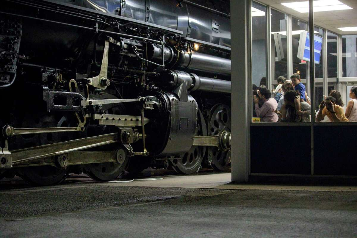 People look at Union Pacific engine 4014, aka the Big Boy, while it is stopped at the Amtrak station on Wednesday, Nov. 6, 2019, in Houston.