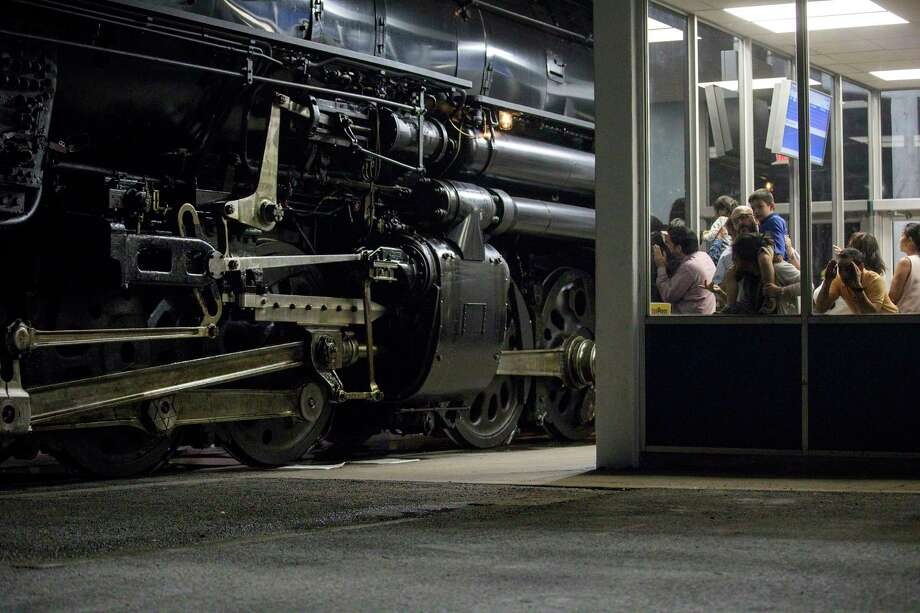 People look at Union Pacific engine 4014, aka the Big Boy, while it is stopped at the Amtrak station on Wednesday, Nov. 6, 2019, in Houston. Photo: Jon Shapley, Staff Photographer / © 2019 Houston Chronicle