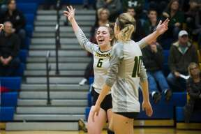 Dow's Francesca Queary cheers after a point during the Chargers' district semifinal against Midland Wednesday, Nov. 6, 2019 at Midland High School. (Katy Kildee/kkildee@mdn.net)