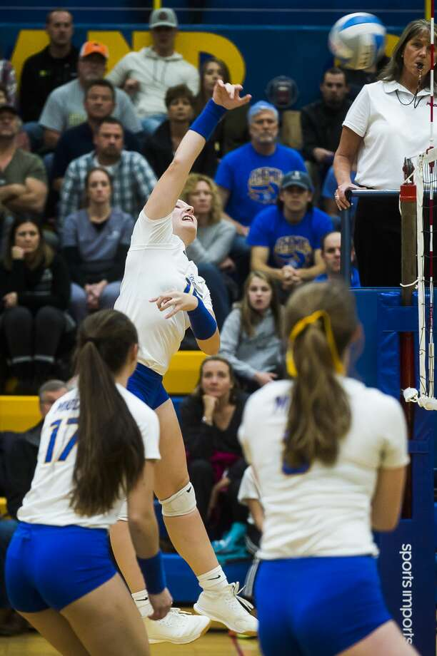 Midland High's Taylor Sanborn spikes the ball in this file photo from last season. (Katy Kildee/kkildee@mdn.net) Photo: (Katy Kildee/kkildee@mdn.net)