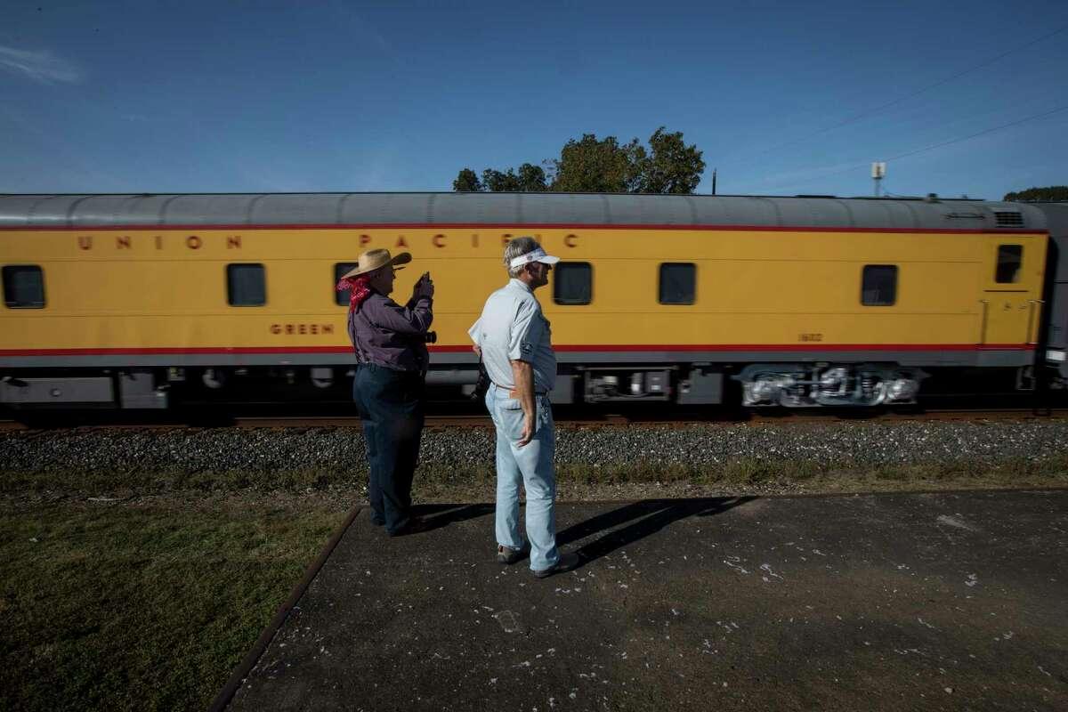 Richard Howe, left, and a man named Harold watch Union Pacific engine 4014, aka the Big Boy, pass through East Bernard on Wednesday, Nov. 6, 2019.