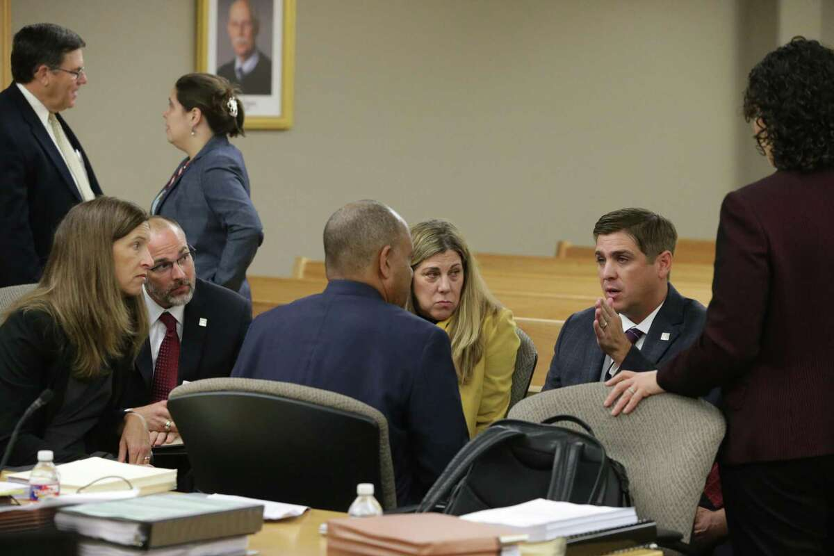 Guadalupe-Blanco River Authority CEO Kevin Patteson, right, talked with attorney Lamont Jefferson before a hearing Wednesday on the agency's management and spending practices.