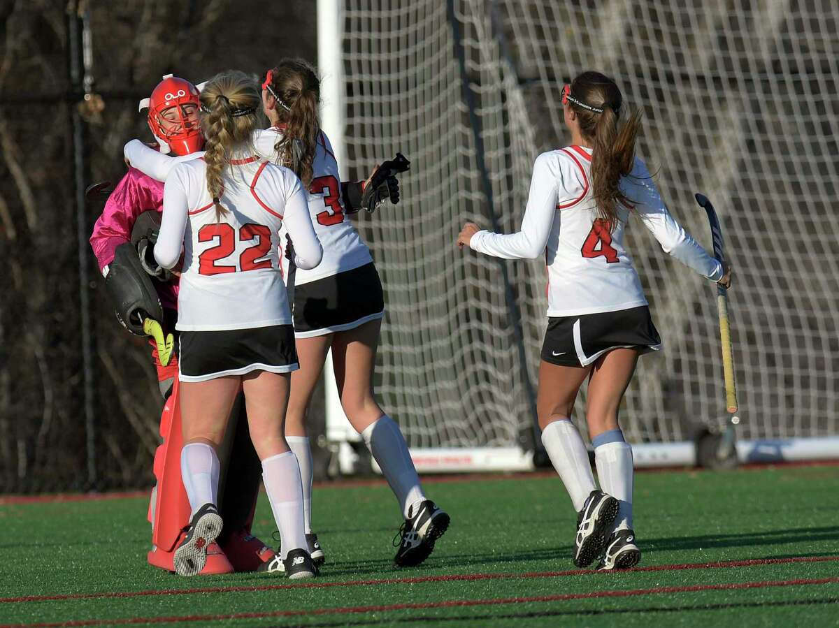 Guilderlandlayers celebrate a 3-1 win against Baldwinsville during a Class A state high school regional semi final field hockey game Wednesday, November 6, 2019, in Gloversville, N.Y. (Hans Pennink / Special to the Times Union) ORG XMIT: 110719_hsfh1_HP101