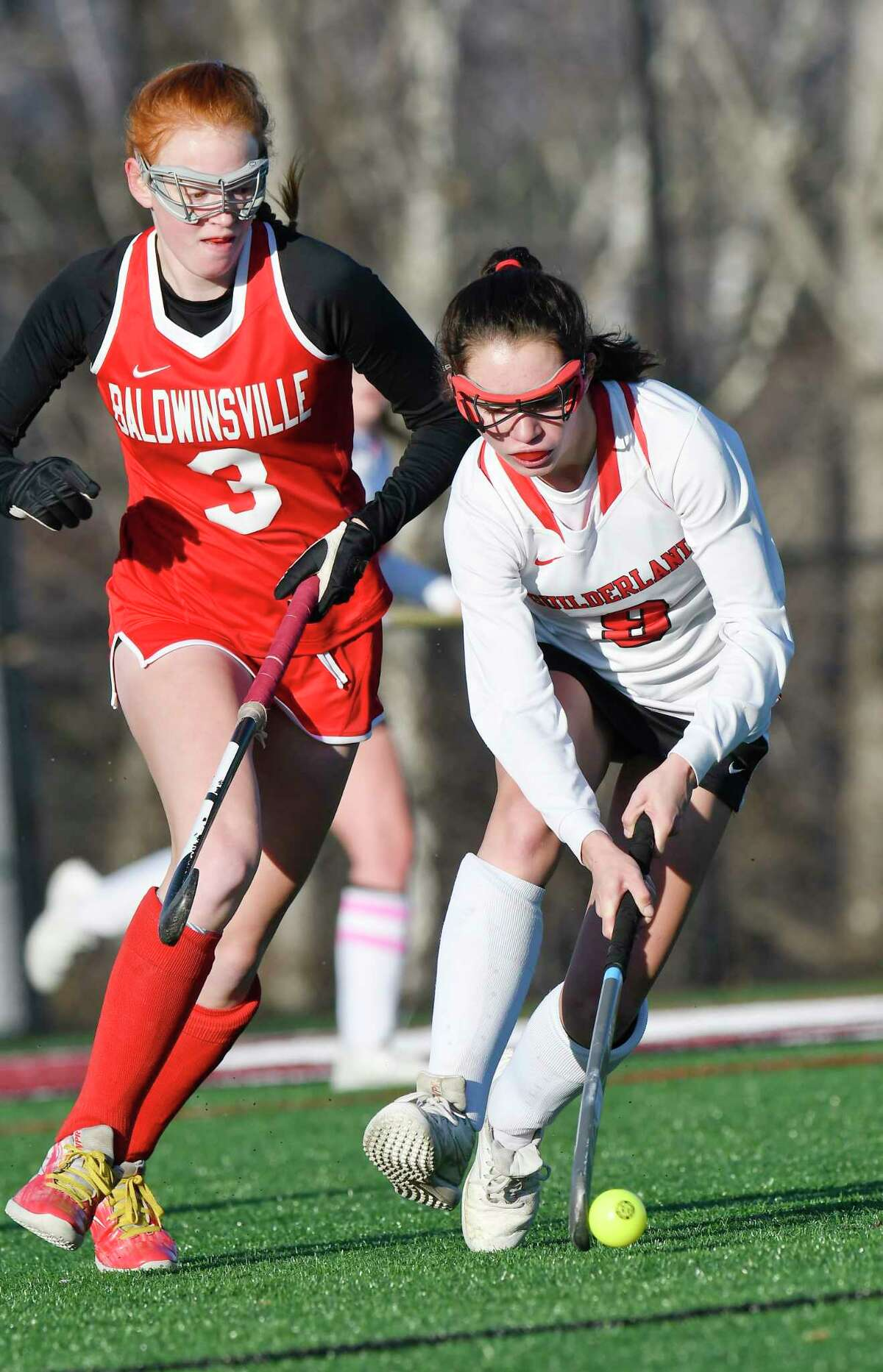 Guilderland's Chelsea King (9) moves the ball in front of Baldwinsville's Sydney Huhtala (3) during a Class A state high school regional semi final field hockey game Wednesday, November 6, 2019, in Gloversville, N.Y. (Hans Pennink / Special to the Times Union) ORG XMIT: 110719_hsfh1_HP102