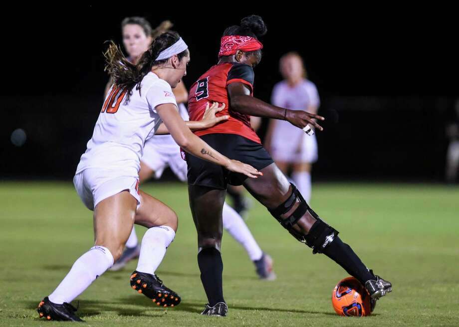 Lamar's Esther Okoronkwo and OSU's Elise Hawn fight for control of the ball during the second half of the game at Lamar Thursday night  Photo taken on Thursday, 08/22/19. Ryan Welch/The Enterprise Photo: Ryan Welch / Ryan Welch/The Enterprise / © 2019 Beaumont Enterprise