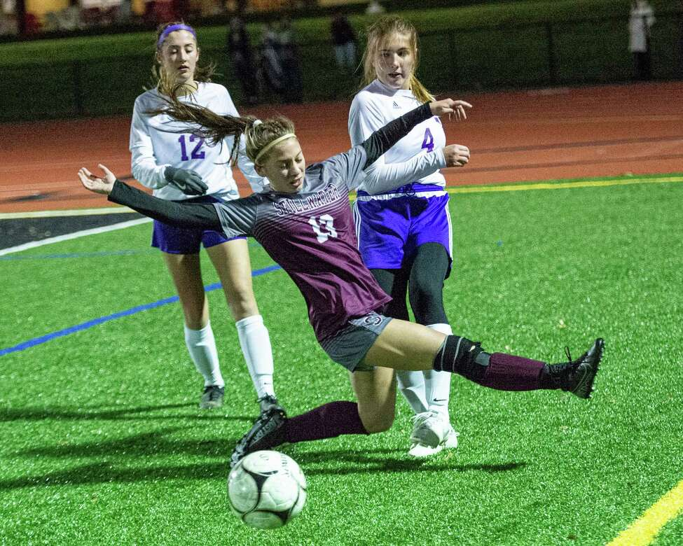 Stillwater midfielder Teya Staie leaps in front of Voorheesville defenders Gabby Rychcik and Megan Romansky during the Section II, Class C finals at Mechanicville High School on Wednesday, Nov. 6, 2019 (Jim Franco/Special to the Times Union.)