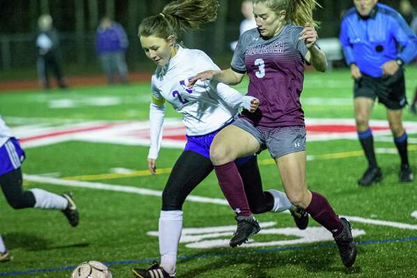 Voorheesville midfielder Julia Gleasman battles with Stillwater Forward Brooke Pickett during the Section II, Class C finals at Mechanicville High School on Wednesday, Nov. 6, 2019 (Jim Franco/Special to the Times Union.)