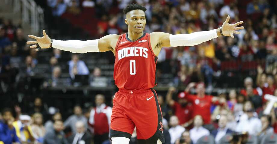 Houston Rockets guard Russell Westbrook (0) reacts to a three-point shot by Houston Rockets guard Austin Rivers (25) in the first half against the Golden State Warriors at the Toyota Center on Wednesday, Nov. 6, 2019 in Houston. Photo: Elizabeth Conley/Staff Photographer