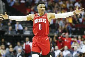 Houston Rockets guard Russell Westbrook (0) reacts to a three-point shot by Houston Rockets guard Austin Rivers (25) in the first half against the Golden State Warriors at the Toyota Center on Wednesday, Nov. 6, 2019 in Houston.