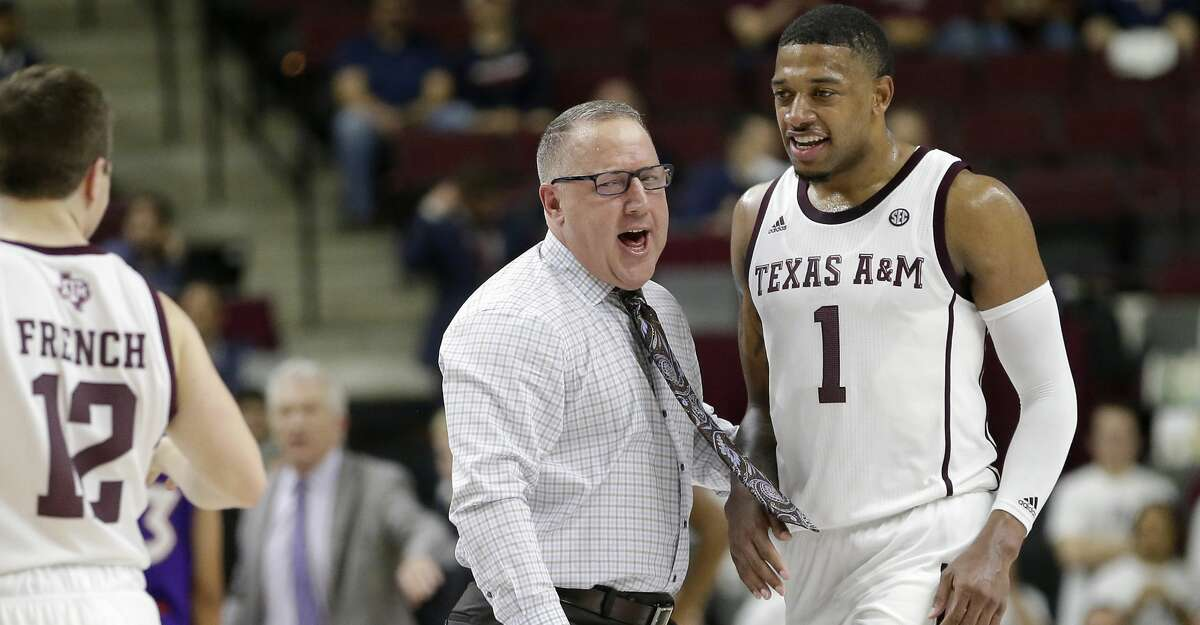 Texas A&M head coach Buzz Williams reacts with Texas A&M guard Savion Flagg (1) after a score and a timeout during the first half of an NCAA college basketball game against Northwestern State Wednesday, Nov. 6, 2019, in College Station, Texas. (AP Photo/Sam Craft)