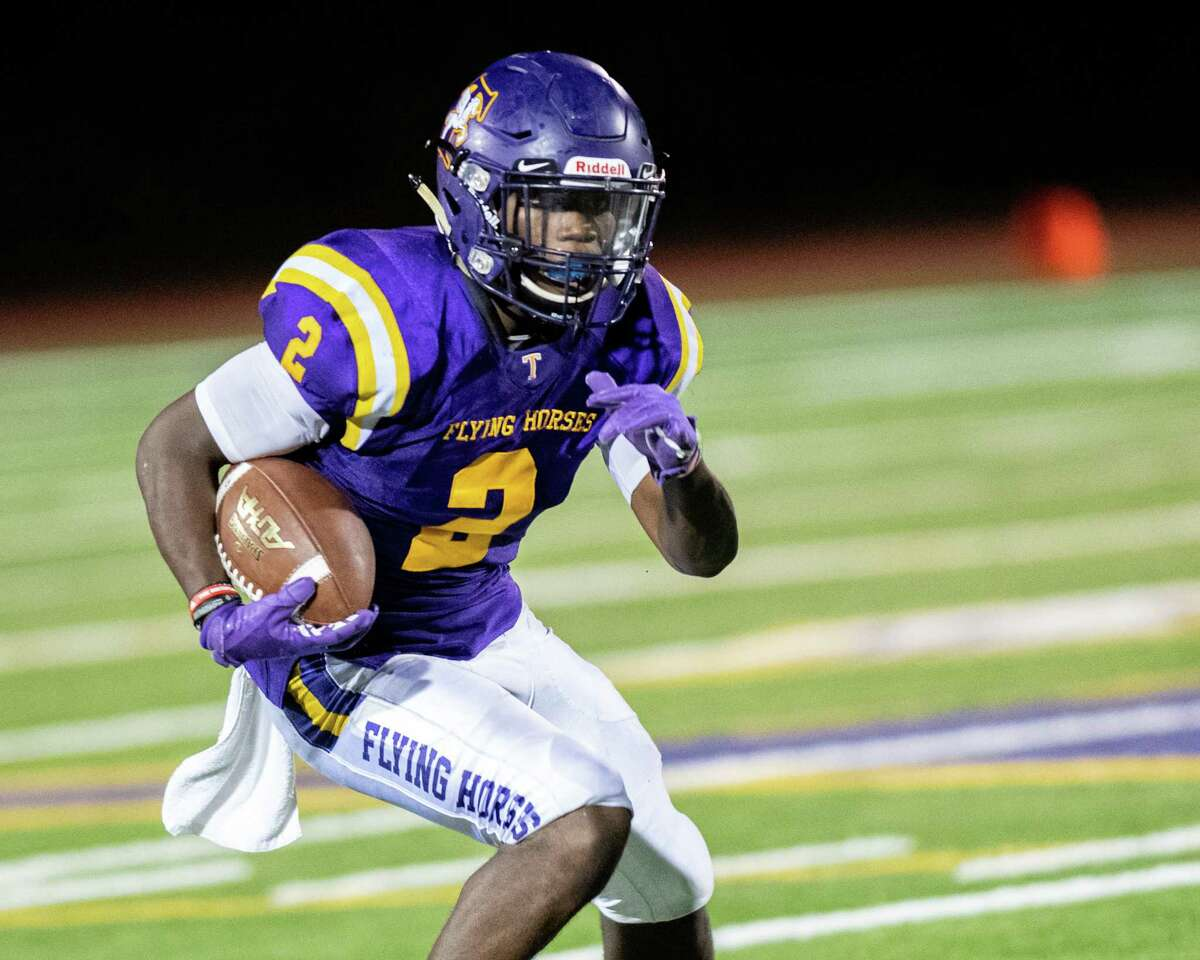 Troy running back Xavier Leigh picks up yardage during a game against CBA at Troy High School on Friday, Sept. 20 (Jim Franco/Special to the Times Union.)