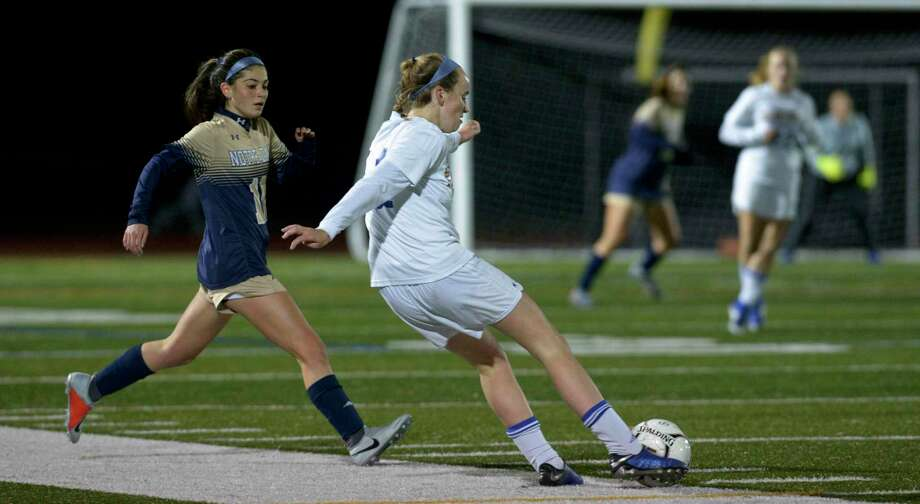 Newtown's Faith O'Hara (14) gets the ball away ahead of Notre Dame-Fairfield's Danielle Yardis (10) in the SWC girls soccer final between No.2 Notre Dame-Fairfield and No. 5 Newtown. Wednesday, November 6, 2019, at Joel Barlow High School, Redding, Conn. Photo: H John Voorhees III / Hearst Connecticut Media / The News-Times