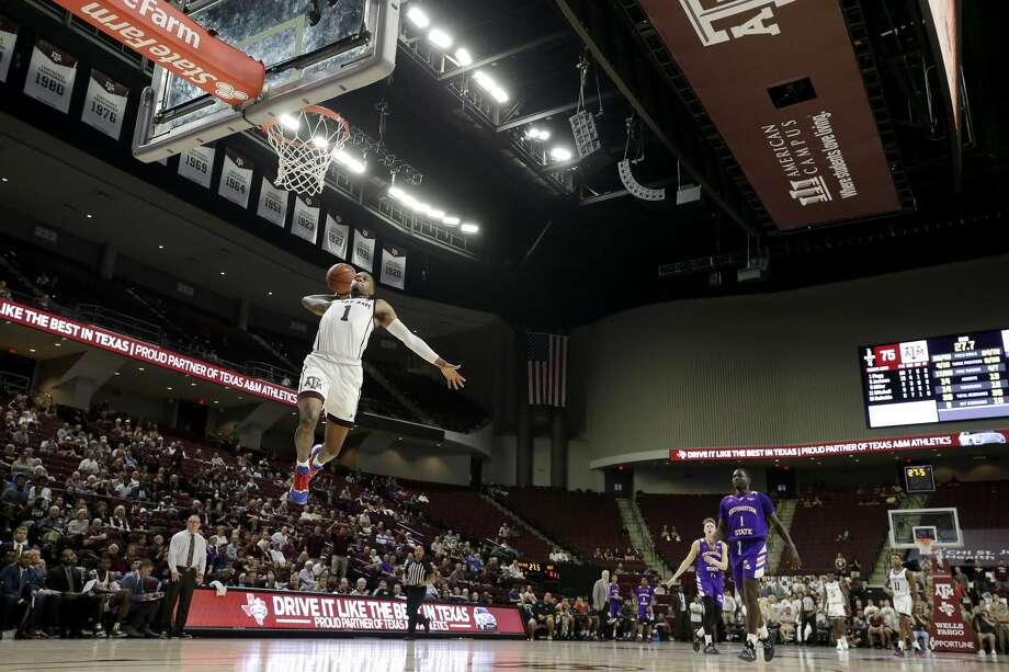 Texas A&M guard Savion Flagg (1) dunks on a fast break against Northwestern State during the second half of an NCAA college basketball game Wednesday, Nov. 6, 2019, in College Station, Texas. (AP Photo/Sam Craft) Photo: Sam Craft/Associated Press