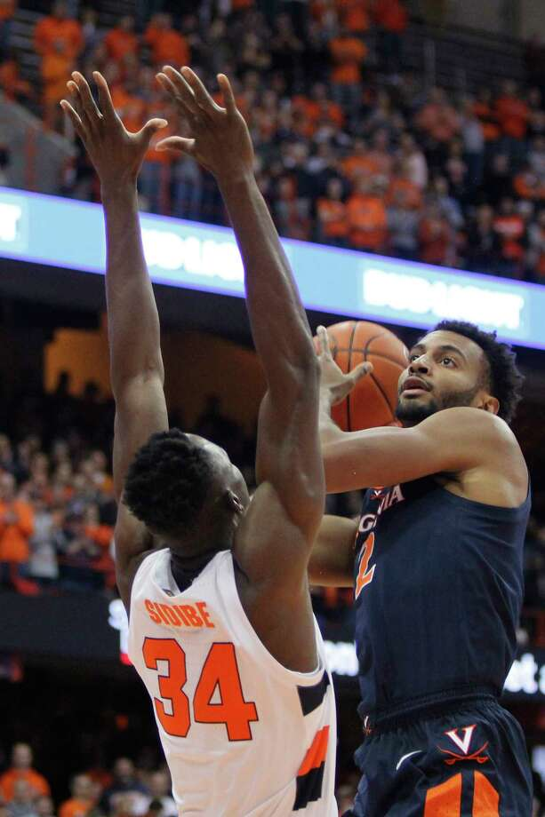 Virginia's Braxton Key, right, shoots over Syracuse's Bourama Sidibe, left, during the first half of an NCAA college basketball game in Syracuse, N.Y., Wednesday, Nov. 6, 2019. (AP Photo/Nick Lisi) Photo: Nick Lisi / Copyright 2019 The Associated Press. All rights reserved.