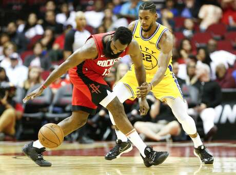 Houston Rockets guard James Harden (13) works on controlling the ball as Golden State Warriors forward Glenn Robinson III (22) applies defense in the second half of game action at the Toyota Center on Wednesday, Nov. 6, 2019 in Houston. Houston Rockets beat the Golden State Warriors 129-112.