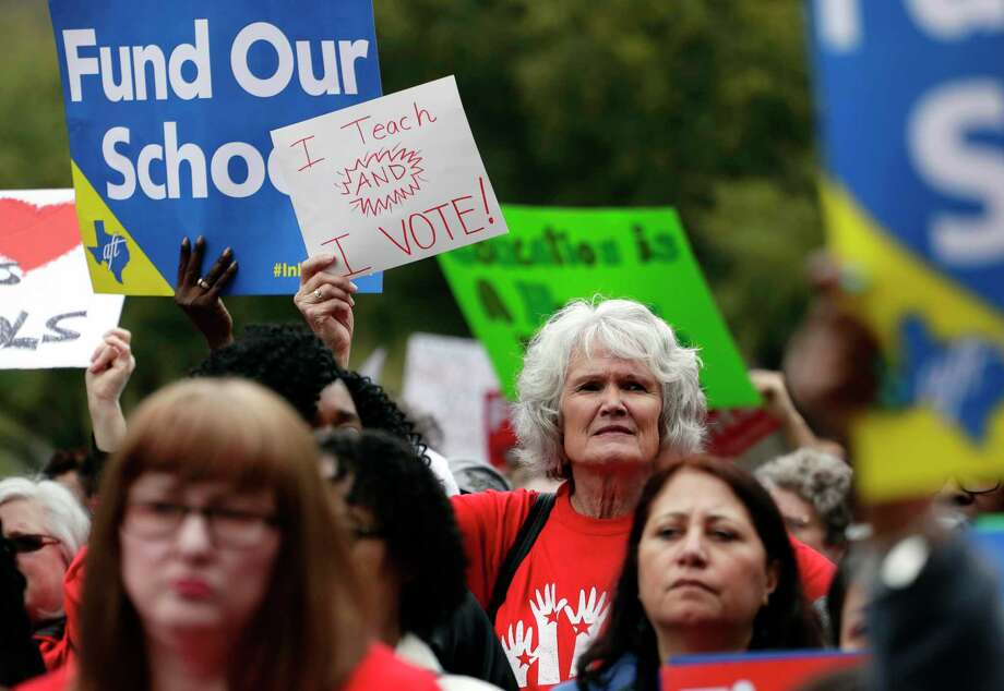 In this March 11, 2019, photo, Educators attend a rally to support funding for public schools at the state Capitol in Austin, Texas. Cost-cutting states are trying to keep schools happy as teacher unrest over low pay and overcrowded classrooms continues. But pressure from voters is forcing states to put more money on the table as much as much as picket lines. (AP Photo/Eric Gay) Photo: Eric Gay, STF / Associated Press / Copyright 2019 The Associated Press. All rights reserved.