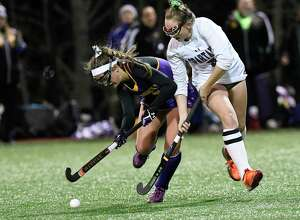 Holland Patent's Haley Acevedo, left and Burnt Hills-Ballston Lake's Paige Thowe battle for control of the ball during a Class B state high school regional semi final field hockey game Wednesday, November 6, 2019, in Gloversville, N.Y. Holland Patent won the game 2-1. (Hans Pennink / Special to the Times Union)      ORG XMIT: 110719_hsfh2_HP112