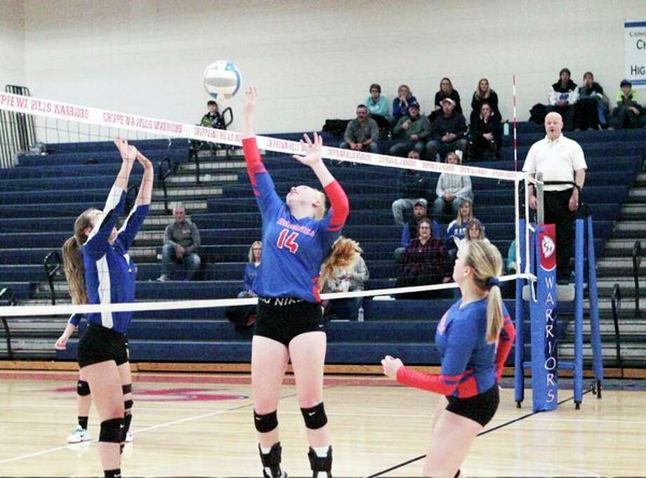 Chippewa Hills sophomore Kendra Ray looks to finesse the ball over the net during the Warriors' 3-0 loss to Gladwin on Wednesday night at CHHS. (Pioneer photo/Joe Judd)