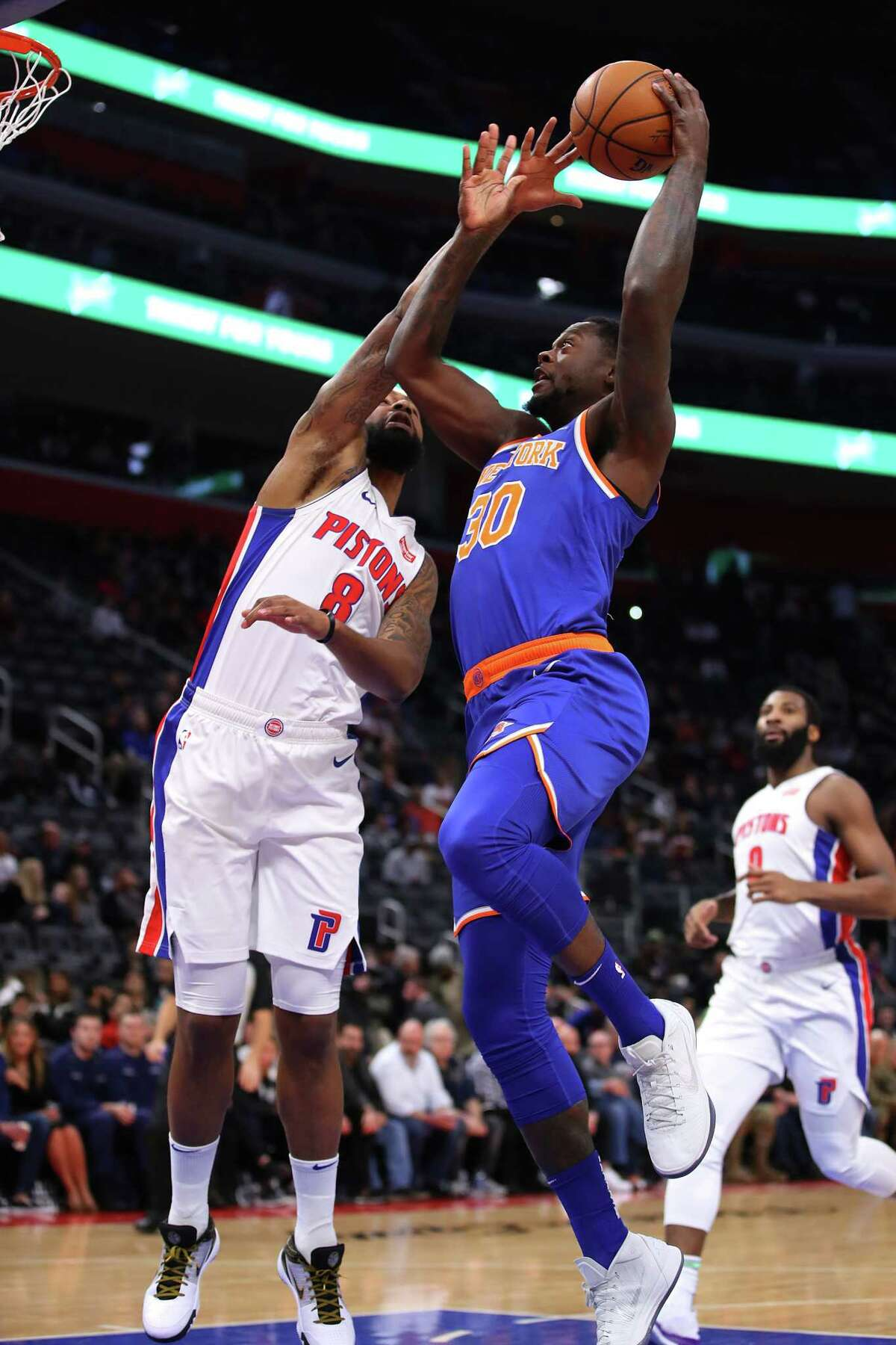 DETROIT, MICHIGAN - NOVEMBER 06: Julius Randle #30 of the New York Knicks tries to get a shot off over Markieff Morris #8 of the Detroit Pistons during the first half at Little Caesars Arena on November 06, 2019 in Detroit, Michigan. NOTE TO USER: User expressly acknowledges and agrees that, by downloading and/or using this photograph, user is consenting to the terms and conditions of the Getty Images License Agreement. (Photo by Gregory Shamus/Getty Images)