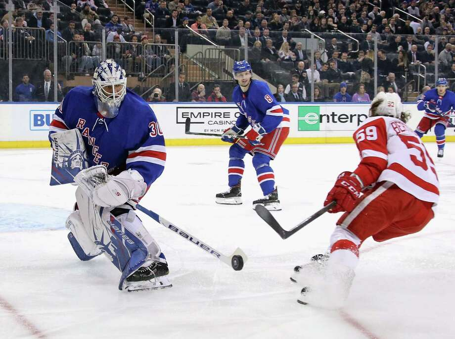NEW YORK, NEW YORK - NOVEMBER 06: Henrik Lundqvist #30 of the New York Rangers shoots the puck away from Tyler Bertuzzi #59 of the Detroit Red Wings during the first period at Madison Square Garden on November 06, 2019 in New York City. (Photo by Bruce Bennett/Getty Images) Photo: Bruce Bennett / 2019 Getty Images