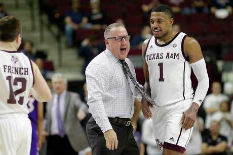 New Texas A&M coach Buzz Williams talks to Savion Flagg, who led the Aggies with 22 points in the victory on Wednesday.