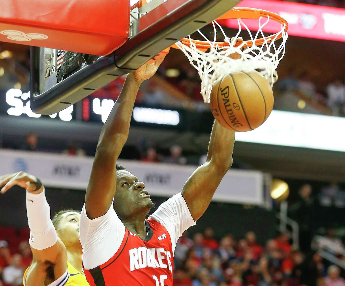 Rockets center Clint Capela bypasses an overmatched Jordan Poole for a first-half dunk Wednesday night.