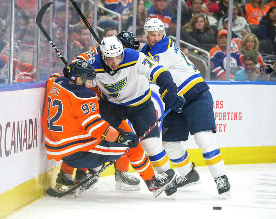 The Blues' Justin Faulk (72) pushes Edmonton's Tomas Jurco (92) off the puck, next to the Blues Jay Bouwmeester (19) in the second period of Wednesday night's game in Edmonton, Alberta. Photo: The Canadian Press Via AP