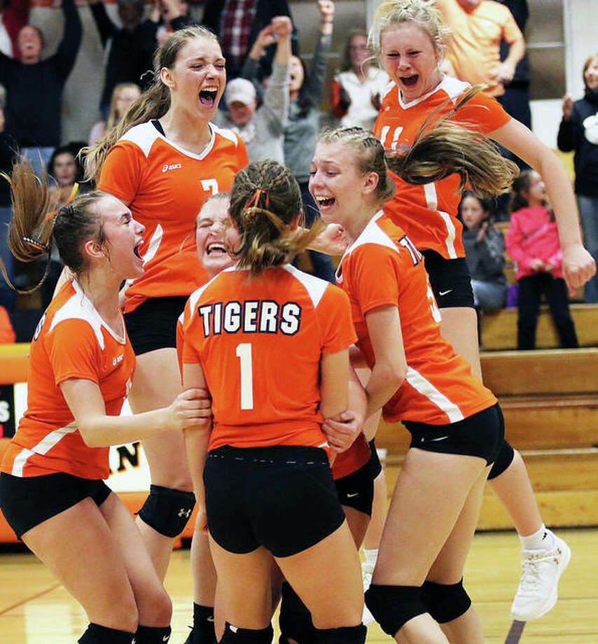 Greenfield's (from left) Baylee Bilbruck, Kirstin Smay (7), Kaitlyn Foiles, Jessa Vetter (1), Alexis Pohlman and Kersty Gibbs (11) celebrate match point on Vetter's kill to beat Waterloo Gibault in the title match of the Lincolnwood Class 1A Sectional on Wednesday in Raymond.