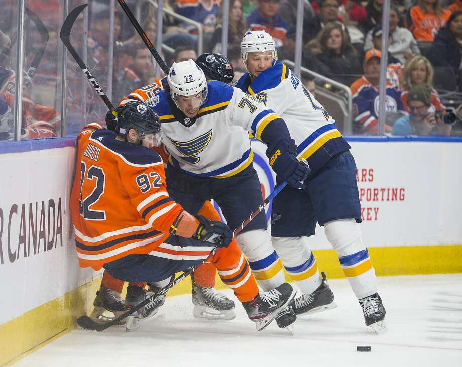 St. Louis' Justin Faulk (72) and Jay Bouwmeester try to push Edmonton's Tomas Jurco off the puck in the second period. Photo: AMBER BRACKEN / Associated Press