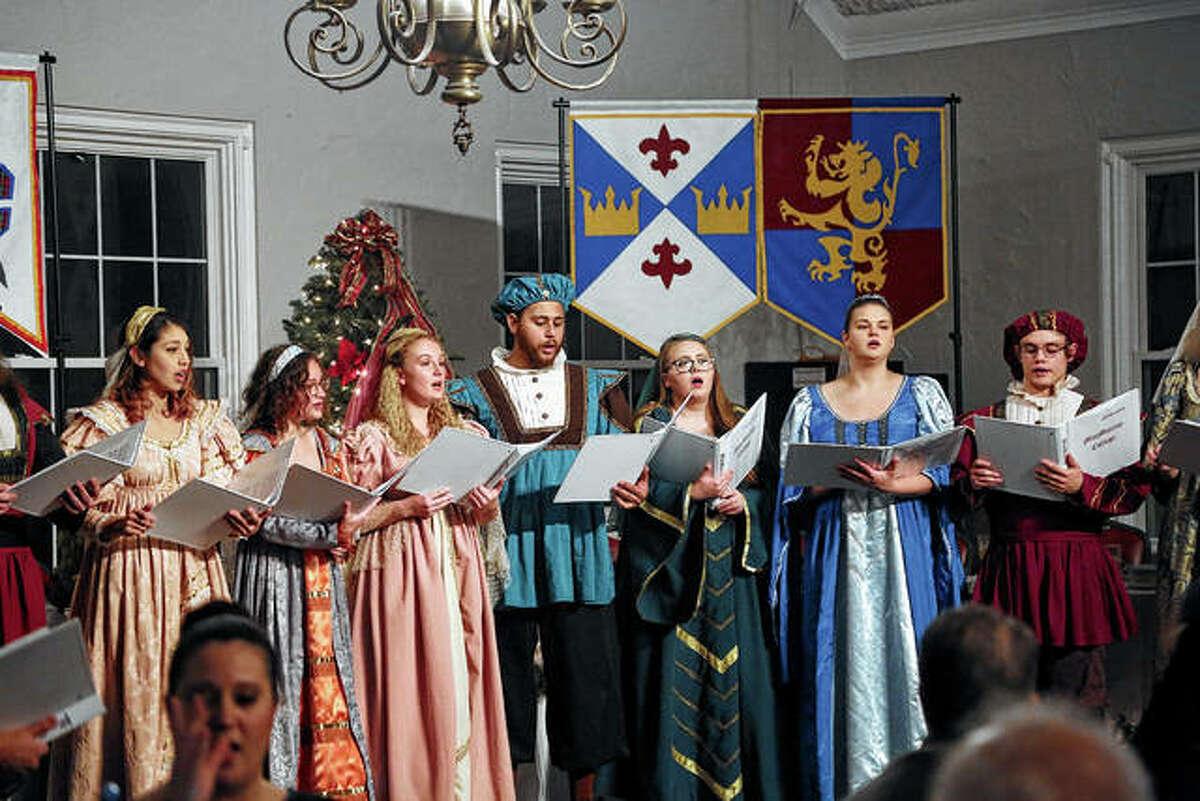 MacMurray College choir members perform during the school's 2018 Madrigal dinner.