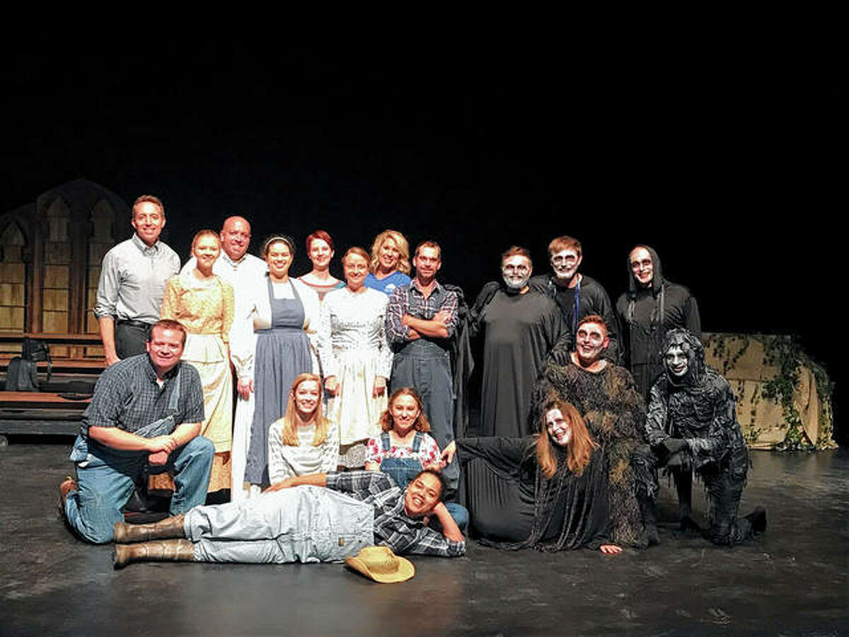 """Members of the cast of """"Bradbury by Bradbury"""" take a group photo during a recent dress rehearsal ahead of this weekend's performances at Illinois College. Many of the cast members in this production also were in the original show 20 years ago at IC."""