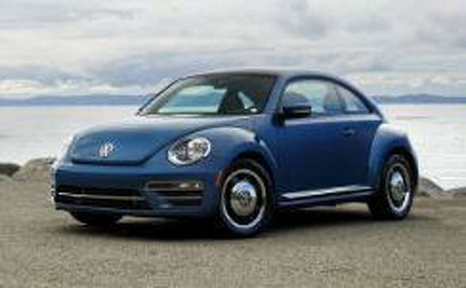 Police are investigating a hit and run crash which occurred on Railroad Street in front of the former New Milford train station around 5 p.m. on Wednesday, Nov. 6, 2019. The evading vehicle was described as a dark colored, possibly blue or black, Volkswagen Beetle. Note: This is not the actual vehicle in the crash. Photo: New Milford Police